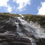 A beautiful water stream on the route toward Ramol hut in the Austrian Alps.