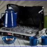 Coleman Triton 2 burner propane stove in a camp.