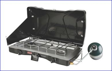 Coleman Triton 2 burner stove with attached propane bottle.