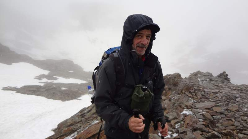 Me in snow and hail is mid summer. Tour to Bivacco Battaglione Ortles at 3122 m above the sea, the Italian Alps.