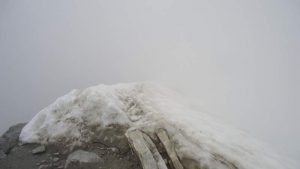 The summit ridge in the snow.
