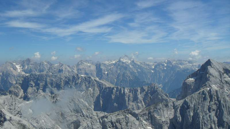 Triglav in the distance, view from the summit of Mangart.