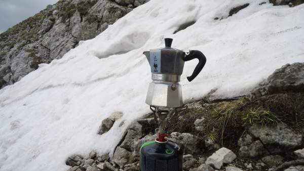Making coffee on the south slopes of Prisojnik mountain in the Slovenian Alps, at around 2300 meters of altitude.