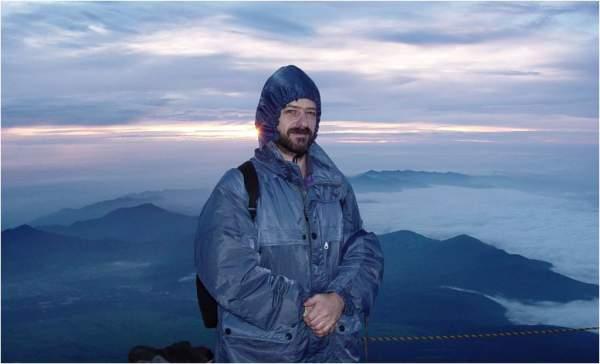 15 years ago, me on the summit of Mount Fuji, before sunrise.
