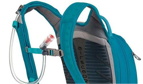 The hydration system with magnetic bite valve and zippered sleeve on the right shoulder strap for water hose.