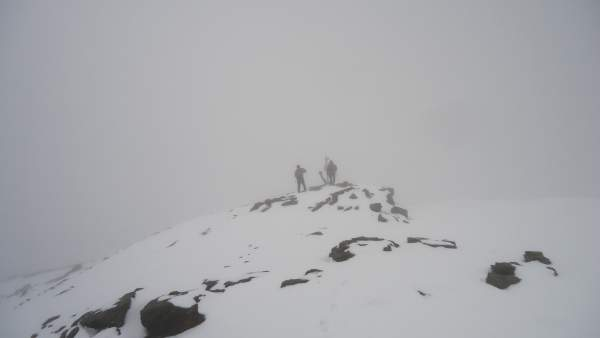 Two men on the summit of Cima Solda (3376 m).