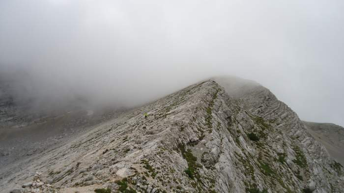 This is the lower section of the ridge which leads to the summit, it is somewhere in the clouds above.