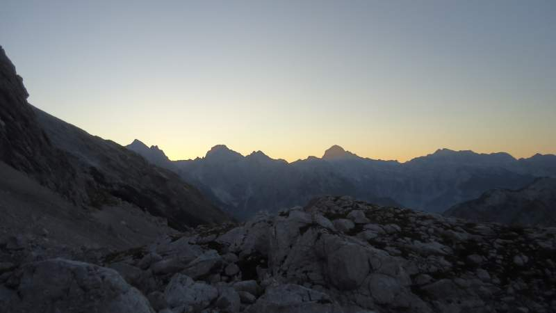 After several hours of walking - sunrise and the silhouette of Triglav in the distance.
