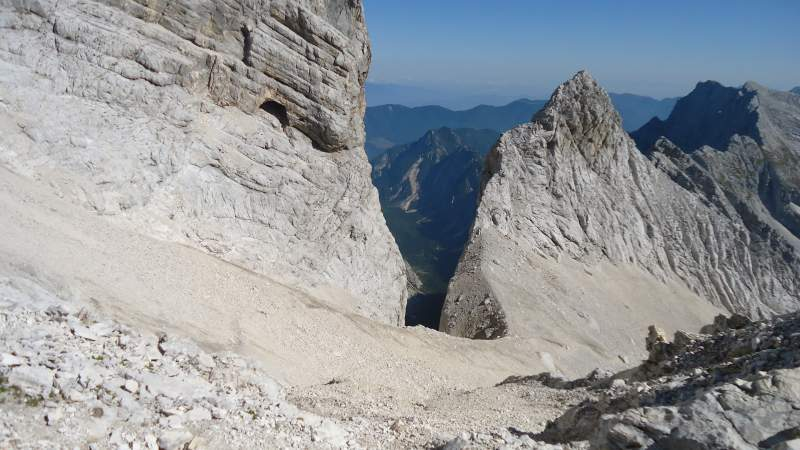 View from the pass through Ozebnik couloir, and Tamar valley behind. There is a route through this narrow couloir but it is officially closed due to falling rocks.