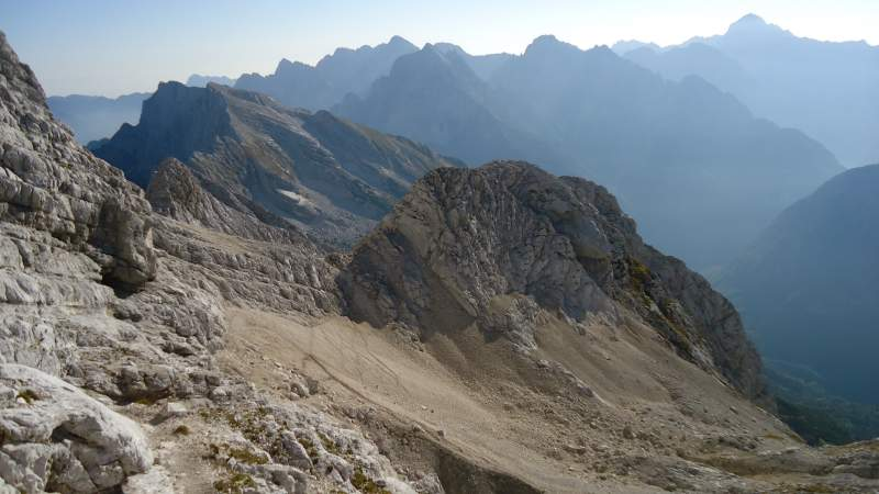 View towards the pass which is on the left-middle part of the picture, from the final summit slope. The place where the route from Zavetiste joins this route is visible, this is the scree area below.