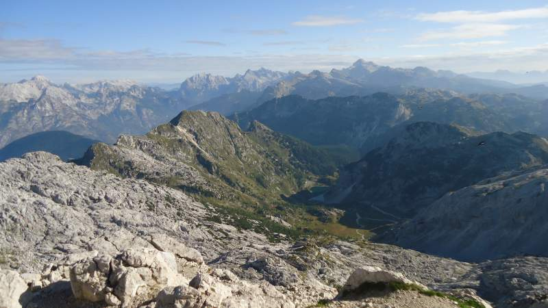 The summit view of the north side route, the lake is far below. The highest Slovenian mountains are in the background, Triglav included.