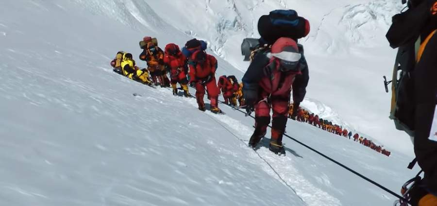 Long line of people on Mt Everest.