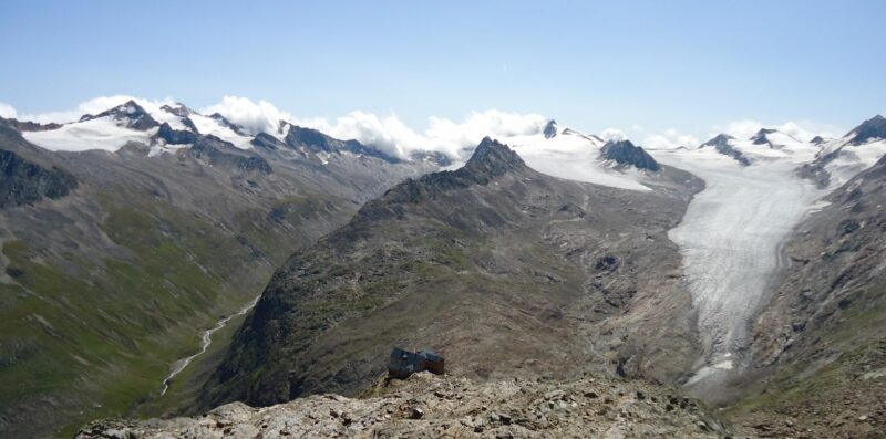 Ramol Hut in Austrian Alps and melting glaciers in the background.