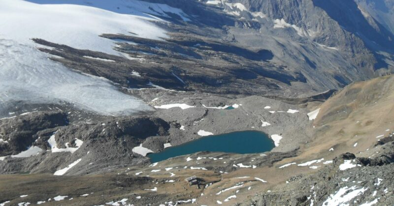 Lake Aurona and Monte Leone hut, view from Wasenhorn, Swiss Alps.
