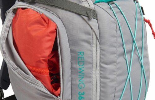 Side upper zippered pocket.