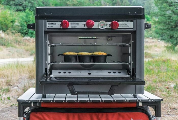 Camp Chef Deluxe Outdoor Camping Oven with a 2-Burner Stove front view.