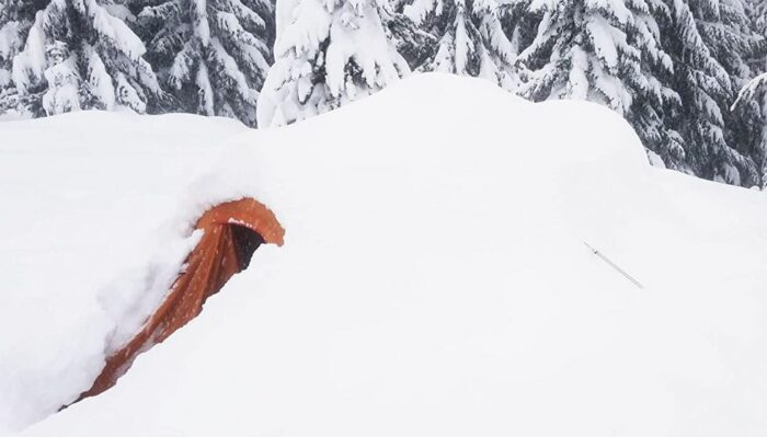 This is ALPS Mountaineering Tasmanian 3-Person Tent under the snow.